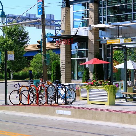 Bicycles parked by a streetcar station