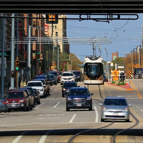 Cars driving alongside a streetcar