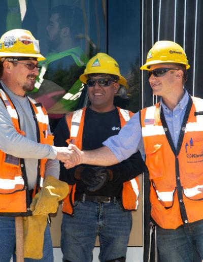 Construction workers handshake